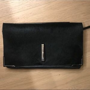 Black pony hair and grained leather clutch